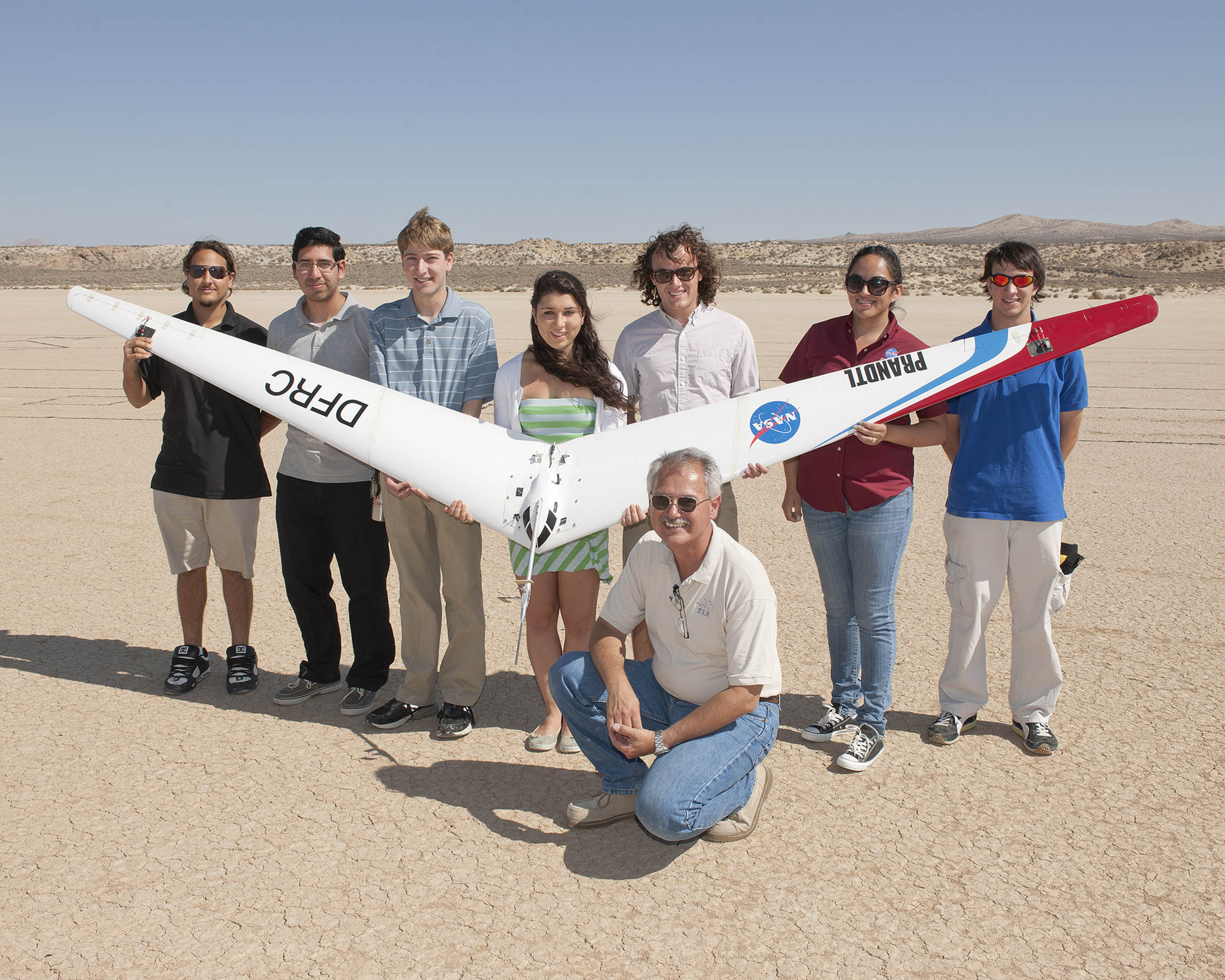 NASA Dryden's Al Bowers and some of the students he mentored in the 2013 NASA Aeronautics Academy display the second subscale Prandtl-D flying wing following its first test flight last August. (NASA / Tom Tschida)